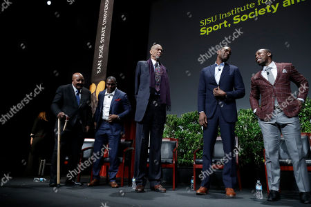 """Former and current professional athletes, from left, Jim Brown, Takeo Spikes, Kareem Abdul-Jabbar, Chris Webber and Anquan Boldin stand at the end of a sports and activism panel entitled """"From Protest to Progress: Next Steps"""", in San Jose, Calif"""