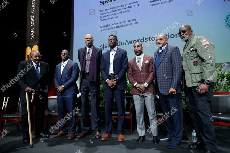 """Former and current professional athletes, from left, Jim Brown, Takeo Spikes, Kareem Abdul-Jabbar, Chris Webber, Anquan Boldin and Tommie Smith pose for photos alongside Dr. Harry Edwards after a sports and activism panel entitled """"From Protest to Progress: Next Steps"""", in San Jose, Calif"""