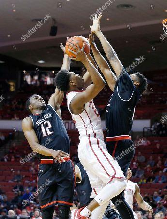 Kameron McGusty, Keenan Evans, Aaron Ross Oklahoma guard Kameron McGusty (20) shoots between Texas Tech guard Keenan Evans (12) and forward Aaron Ross (15) during an NCAA college basketball game between Texas Tech and Oklahoma in Norman, Okla., . Oklahoma won 84-75