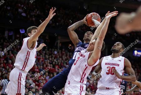 Tony Carr, Ethan Happ, Zak Showalter, Vitto Brown Penn State's Tony Carr (10) shoots against Wisconsin's Ethan Happ, left, Zak Showalter (3) and Vitto Brown during the first half of an NCAA college basketball game, in Madison, Wis