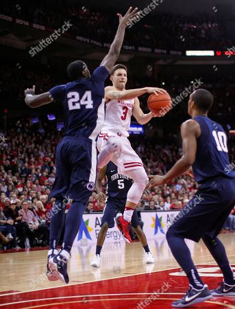 Zak Showalter, Mike Watkins, Tony Carr Wisconsin's Zak Showalter (3) passes as Penn State's Mike Watkins (24) and Deividas Zemgulis (10) defned during the second half of an NCAA college basketball game, in Madison, Wis. Wisconsin won 82-55