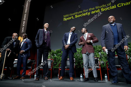 """Jim Brown, Takeo Spikes, Kareem Abdul-Jabbar, Chris Webber, Anquan Boldin, Tommie Smith Former and current professional athletes, from left, Jim Brown, Takeo Spikes, Kareem Abdul-Jabbar, Chris Webber, Anquan Boldin and Tommie Smith stand at the end of a sports and activism panel entitled """"From Protest to Progress: Next Steps"""", in San Jose, Calif"""