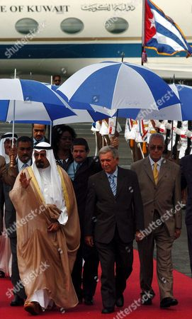 Cuban Education Minister Luis Ignacio Gomez (c) Greets Kuwait's Deputy Prime Minister and Foreign Affairs Minister Sheikh Muhammad Sabah Al-salem Al-sabah (l) Upon His Arrival in Havana's International Airport Tuesday 12 September 2006 in Havana Cuba the 14th Non-aligned Movement Summit is Underway in Havana where Anti-american Leaders Such As Iranian President Mahmoud Ahmadinejad and His Venezuelan Counterpart Hugo Chavez and Other Leaders of Developing Countries From Around the Globe Are Expected to Attend the Meeting Will Run Through Septembre 16 Cuba Havana