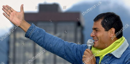 Stock Picture of Ecuadoran Presidential Hopeful Leftist Rafael Correa Greets His Followers During a Motorized Convoy Held Through the Main Streets of Quito Ecuador on Thursday 23 of November 2006 Correa Will Confront Banana Tycoon Alvaro Novoa in the Second Presidential Elections Round on Sunday 26 November 2006 Ecuador Quito