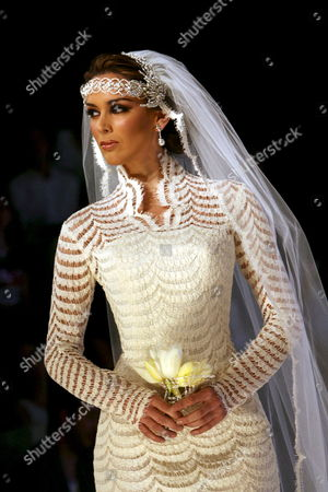 A Model Takes to the Catwalk Wearing a Wedding Dress by Mexican Designer Nicolas Felizola During the Mexico Fashion Week in Mexico City Mexico 03 October 2007 Mexico Mexico City