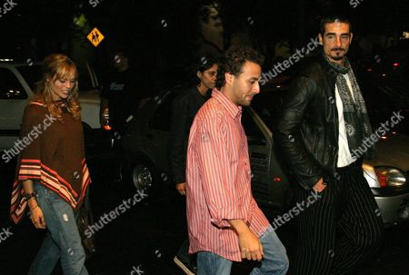 Backstreet Boys Pop Group Members Kevin Richardson (r) His Wife Kristin Richardson (l) and Howie Dorough (c) Enter a Restaurant in Mexico City Mexico Late Thursday 14 October 2004 the Backstreet Boys Will Be Performing on Friday 15 and Saturday 14 in the Sports Palace Mexico City Mexico Mexico