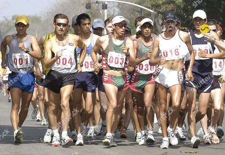Ecuadorean Jefferson Perez (001) Polish Robert Korzeniowski (004) Mexican Olympic Medallist Noe Hernandez (003) Mexican Cristian Berdejo (030) and Ecuadorean Erick Guevara (016) Head the 20 Km Walk of the Grand Prix of Tijuana Mexico Saturday 20 March 2004 Walkers From Different Countries From Around the World Participate in Tijuana Grand Prix Mexico Tijuana