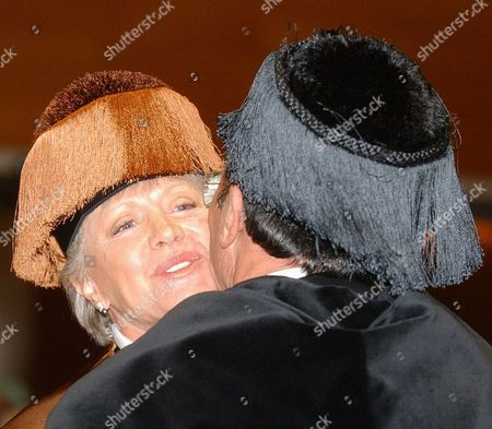 Rector of the Valencia Polytechnic University Justo Nieto (r) Kisses Jordanian Princess Muna Al Hussein (l) Mother of King Abdullah Ii After She was Invested As Doctor Honoris Causa by the Valencia University on Thursday 02 October 2003 Spain Valencia