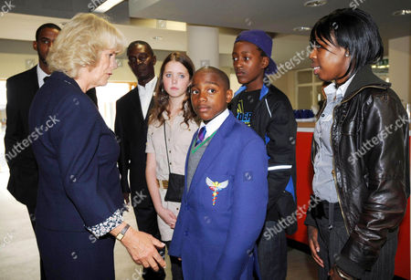 Stock Image of Camilla, Duchess of Cornwall meets members and young riders including (from left) rider and youth worker (concealed) Aaron Kidanie, youth worker Harry Davis, rider Chloe Rice, rider Ransford 'Junior' Reid, rider Stephan Reid and Shannel Foster, the sister of murdered youth worker and rider Nathan Foster