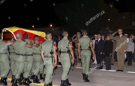 Spanish Prince Felipe (r) Salutes As Vice President Maria Teresa Fernandez De La Vega (2-r) and Home Office Minister Jose Antonio Alonso (3-r) Look on As the Coffin of One of Two Spanish Soldiers who Were Killed in Afghanistan in a Landmine Explosion Arrives at Torrejon De Ardoz Airport in Madrid Spain Early 26 September 2007 the Two Soldiers Were Killed when Their Military Convoy Ran Over a Landmine Near the Town of Shewan Western Afghanistan 24 September where They Took Part in the Nato-led International Security Assistance Force (isaf) Spain Torrejon De Ardoz
