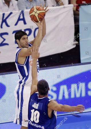 Greece's Panagiotis Vassilopoulos Throws Over Serbian Marko Jaric During Their Fiba Europe Basketball Championship Match Against Serbia Played at the Sports Arena in Granada Southern Spain 04 September 2007 Spain Granada