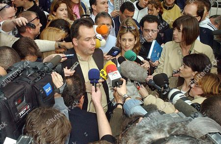 Leicester City?s Executive Manager Tim Davis (l) Answers to Journalists Next to Leicester Players' Lawyer Ana Ruiperez (centre Right) After Leaving the Court in Cartagena Town South-eastern Spain Friday 05 March 2004 Leicester City's Keith Gillespie Paul Dickov and Frank Sinclair Have Been Remanded in Custody by an Investigating Judge Probing an Alleged Assault on Three Women in a Spanish Hotel Spain Cartagena