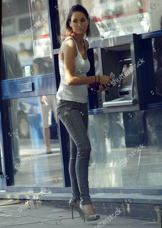 Nicole Henry drawing out cash at a cashpoint