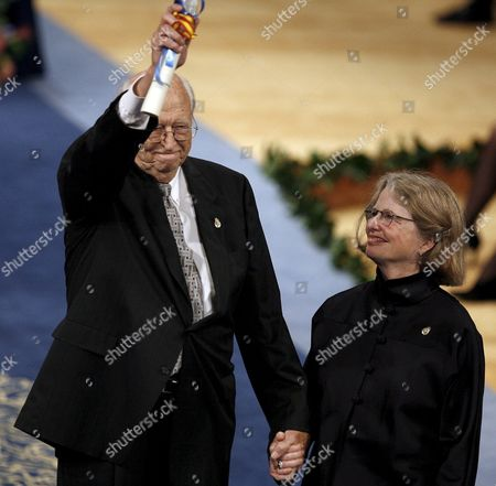 William H Gates (l) Co-chairman of the Bill and Melinda Gates Foundation and Father of Microsoft's Founder and Chairman Bill Gates and His Wife Mimi Acknowledge the Applause After Receiving the Prince of Asturias International Award International Cooperation Friday 20 October 2006 in the Campoamor Theater in Oviedo Northern Spain Spain Oviedo