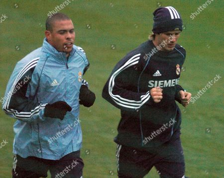 Real Madrid Players Brittish David Beckham (r) and Brazilian Ronaldo Luis Nazario De Lima (l) Train in the Rain at Their New Sport City of Valdebebas Madrid on Monday 14 November 2005 Prior to Their Crucial Match Against Fc Barcelona Saturday 19 November 2005 at the Santiago Bernabeu Stadium in Madrid Spain Madrid