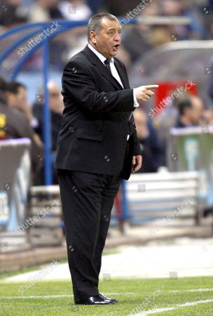 Aberdeen's Coach Jimmy Calderwood Gives Instruction to His Players During Their Uefa Cup Soccer Match Against Atletico Madrid at Vicente Calderon Stadium in Madrid Spain 29 November 2007 Spain Madrid
