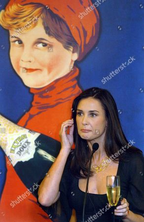 Us Actress Demi Moore Poses During the Press Conference Held in Barcelona Cataluna Northeastern Spain Tuesday 11 October 2005 Moore and Spanish Acto Gabino Diego Are Filming a Tv Spot For Christmas Time of a Well-known Spanish Sparkling Wine Spain Barcelona