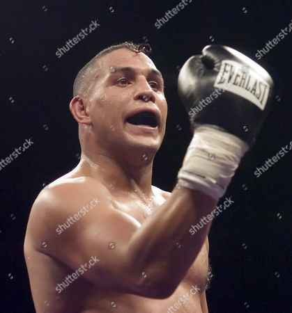 Stock Picture of Boxing Great Hector 'Macho' Camacho Calls out Raul Mu±oz at the End of There Non-title Fight Saturday 9 July 2005 at the Tucson Convention Center As Soon As the Fight was Over They Started a Brawl in the Middle of the Ring That Had to Be Broken Up by the Corner Trainers and Referee Macho was Fighting on the Card with His Son Hector Jr who Won His Fight Easily This is Only the Second Time a Father and Son Have Fought on the Same Card Hector Macho Camacho Won a Close Fight with a Unanimous Decision in Ten Rounds at Age 43 United States Tucson