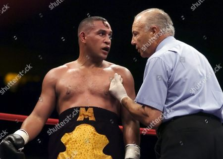 Boxing Great Hector 'Macho' Camacho is Warrned by Referee Bobby Ferreo About Dirty Fighting in the 9th Round in a Fight with Raul Munoz of Mexico Saturday 9 July 2005 at the Tucson Convention Center Macho was Fighting on the Card with His Son Hector Jr who Won His Fight Easily This is Only the Second Time a Father and Son Have Fought on the Same Card Hector Macho Camacho Won a Close Fight with Barra After He Got a Unanimous Decision After Ten Rounds of Boxing at Age 43 United States Tucson