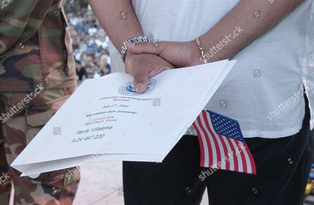 Renfy Villalona Holds His Certiciate of Citizenship After Reciting Vows of Allegiance and Becoming a Us Citizen During a Us Citizenship Ceremony That was Followed by a Concert Featuring Julio Iglesias Jr and a Fireworks Display Sunday 04 July 2004 at Lummus Park on Ocean Drive Miami Fl United States Miami