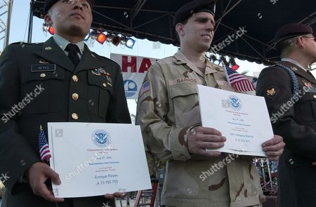 (l-r) Anh Hong Vuong From Vietnam and John William Barros From Colombia Hold Their Certificate of Citizenship During a Us Citizenship Ceremony That was Followed by a Concert Featuring Julio Iglesias Jr and a Fireworks Display Sunday 04 July 2004 at Lummus Park on Ocean Drive Miami Fl United States Miami