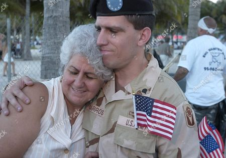From Left Miriam Leyba Mother of John William Barros Are Overcome with Emotion After Barros Received His Us Certificate of Citizenship After Reciting Vows of Allegiance During a Us Citizenship Ceremony That was Followed by a Concert Featuring Julio Iglesias Jr and a Fireworks Display This Sunday 04 July 2004 at Lummus Park on Ocean Drive Miami Fl United States Miami