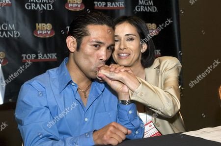 Salvadoran Carlos Hernandez (l) From West Covina California Sits with His Manager-wife Veronica Hernandez (r) on Thursday July 29 2004 During the Press Conference at the Mgm Grand Hotel in Las Vegas Nevada Us Hernandez Will Fight Erik Morales of Tijuana Mexico For the Wbc/ibf World Super Featherweight Title at Mgm Grand Garden Arena Next Saturday July 31 2004 United States Las Vegas