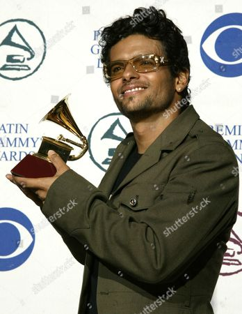Puerto Rican Singer and Composer Robi Draco Rosa Holds His Award He Received in the Category 'Best Music Video (1 Song Only)' During the 5th Annual Grammy Awards at the Shrine Auditorium Los Angeles Wednesday 1 September 2004 United States Los Angeles
