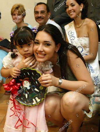 Miss Universe Amelia Vega (r) Hugs an Unidentified Girl who Suffers From Down Syndrome at Los Pipitos School in Managua Friday 27 February 2004 Amelia Vega Will Participate in the Election of Miss Nicaragua Saturday 28 February at Ruben Dario National Theater in Managua Nicaragua Managua