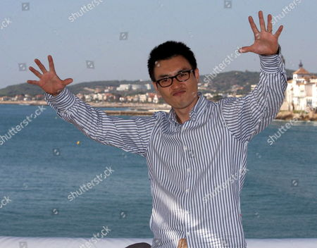 Stock Picture of South Korean Film-maker Ryoo Seung-wan Gestures As He Poses For Photographers During the Presentation of His Film 'The City of the Violence' at the Sitges International Film Festival in Sitges Catalonia Region Spain 13 October 2007 Spain Sitges