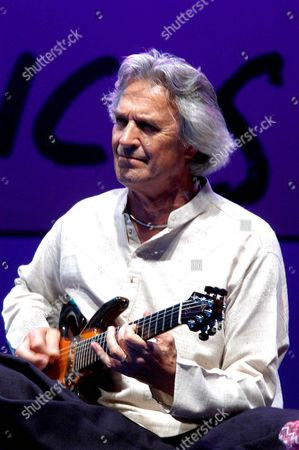 British Guitarist John Mclaughlin Ex Leader of Mahavishnu Orchestra Accompanied by Virtuous Indians Zakir Hussain and U Shrinivas (not in the Picture) Performs During the X Edition of La Mar De Musicas Festival in Cartagena (south-east of Spain) Late Wednesday 07 July 2004 Spain Cartagena