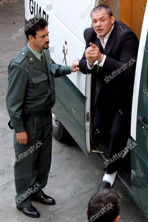 British Suspect Tony King Arrives at Malaga's Courthouse Escorted by a Spanish Civil Guard Agent on the Fourth Day of His Murder Trial in Malaga Southern Spain Tuesday 25 October 2005 Spanish Police Arrested King in 2003 After Being Suspected of Murdering 17-year-old Sonia Carabantes King is Also Suspected of the 1999 Killing of 19-year-old Rocio Wanninkhof Near the Costa Del Sol Resort of Marbella Spain Malaga