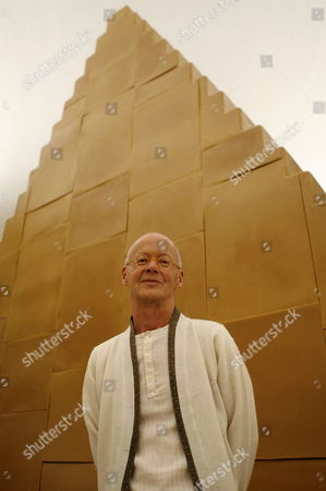 German Artist Wolfgang Laib Poses Besides His Work 'Nowhere-everywhere' a Zigurat Made of Beeswax Over a Wooden Structure During the Presentation of His Exhibition 'No Beginning - No End' at Reina Sofia Museum in Madrid Spain 17 April 2007 Spain Madrid