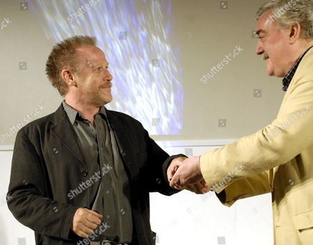 French Producer Nicolas Philibert (l) Receives From Huesca Festival Director Jose Maria Escriche (r) an Award in Recognition of His Work As One of the Best Documentary Makers During Huesca?s Cinema Festival Gala in Huesca Northern Spain 08 June 2007 Spain Huesca