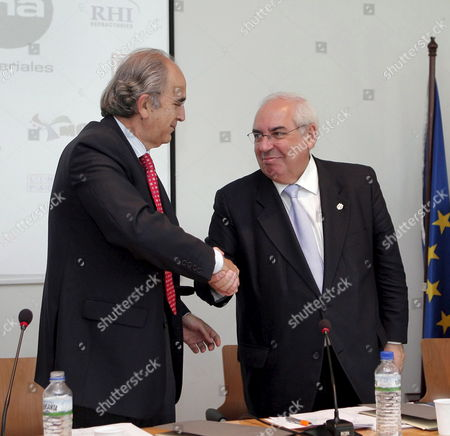 Asturias Regional President Vicente Alvarez Areces (r) and Arcelor Mittal President in Spain Juan Estadellas Valle (l) Shake Hands After Signing an Agreement in Aviles Northern Spain 22 May 2007 the Deal Consist of a Series of Research Projects to Be Developed in the Next Five Years with an Estimate of 100 Million Euros the Aviles' Centre of Technological Development on Iron and Steel Industry Will Be Part of This Project Spain Aviles