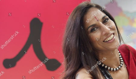 Stock Photo of Indian Writer Shobhaa De Smiles During the Presentation of Her Book 'Nights of Bollywood' in Madrid Central Spain 13 March 2008 De's Novel Tells the Obscure Story Which is Behind Bollywood's Film Industry Spain Madrid