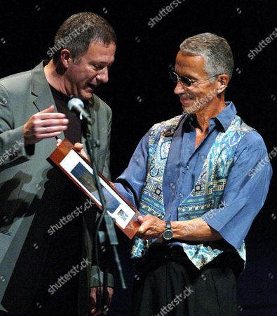 The Director of the 40th San Sebastian's Jazz Festival Miguel Marin (l) Hands Over the 'Donostiako Jazzaldia' Award to the Legendary Us Jazz Pianist Keith Jarrett For His Contribution to the Jazz Music in San Sebastian Basque Country Northern Spain on Sunday 24 July 2005 Spain San Sebastian