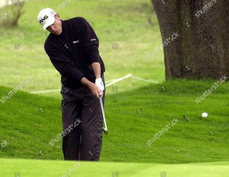 Australian Golfer Peter Fowler Eyes the Ball During the Third Day of the 2003 Telefonica Open De Madrid Golf Tournament at the Club De Campo in Madrid on Saturday 25 October 2003 Spain Madrid