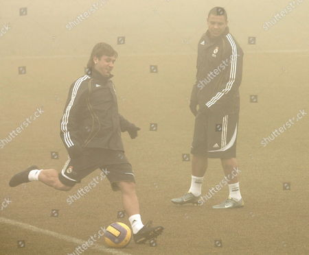 Real Madrid Soccer Players Brazilian Luis Nazario De Lima 'Ronaldo' (r) and Italian Antonio Cassano Warm Up During the Team Training Session in Madrid Friday 19 January 2007 Madrid Soccer Team Captain Raul Gonzalez Blanco Today Expressed the Discomfort of the Team Players After the Criticism of Club President Ramon Caderon and After the Team was Eliminated From the Spanish King Cup After Yesterday's Draw Against Betis Spain Madrid