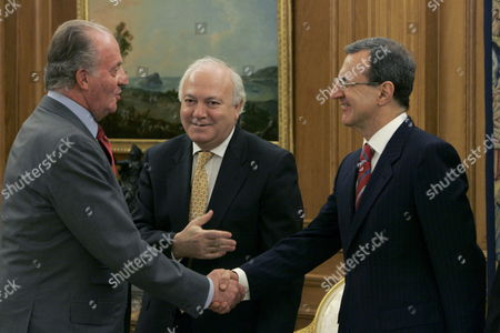 Stock Picture of Spain's King Juan Carlos (l) Shakes Hands with United Nation's Director General Sergei Ordzhonikidze (r) As Spanish Foreign Affairs Minister Miguel Angel Moratinos Looks on During an Audience at Royal Palace in Madrid Spain Wednesday 28 February 2007 Moratinos and Ordzhonikidze Signed Before a Memorandum About the Remodelling of Xx Hall of Nations Palace Spanish Artist Miquel Barcelo Will Be the Person in Charge of the Project Spain Madrid