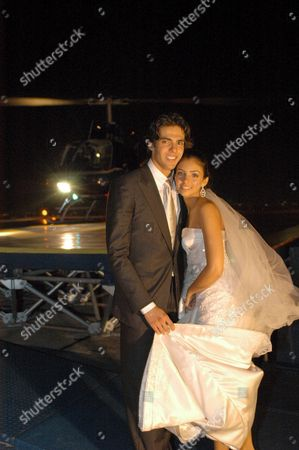 Brazilian Soccer Player Kaka (l) 23 Forward of Italian Team Milan and His Bride Model and Student Caroline Celico 18 Pose After Their Wedding Held at an Evangelist Church in Sao Paulo Brazil Late Friday 23 December 2005 Around 600 People Attended the Wedding at an Evangelist Church and the Party Held at a Luxury Hotel Amongst Them Brazilian Real Madrid's Soccer Star Ronaldo Brazil Rio De Janeiro