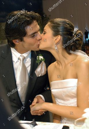 Brazilian Soccer Player Kaka (l) 23 Forward of Italian Team Milan Kisses His Bride Model and Student Caroline Celico 18 During Their Wedding in Sao Paulo Brazil Late Friday 23 December 2005 Around 600 People Attended the Wedding at an Evangelist Church and the Party Held at a Luxury Hotel Amongst Them Brazilian Real Madrid's Soccer Star Ronaldo Brazil Rio De Janeiro