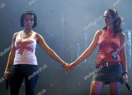 Russian Singers Lena Katina (r) and Julia Volkova (l) of the Group Tatu Perfom During a Concert at the Sport Palace in Mexico City Late Friday Night 14 July 2006 Mexico Ciudad M?xico