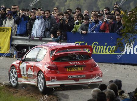 Third in the Provisional General Qualifying with 58 Points Britain's Richard Burns Drives His Peugeot During a Practice Session of the Cataluna Rally Thursday 23 October 2003 in Lloret De Mar in Girona Northeastern Spain the Three-day Rally Will Start 24 October Spain Lloret De Mar