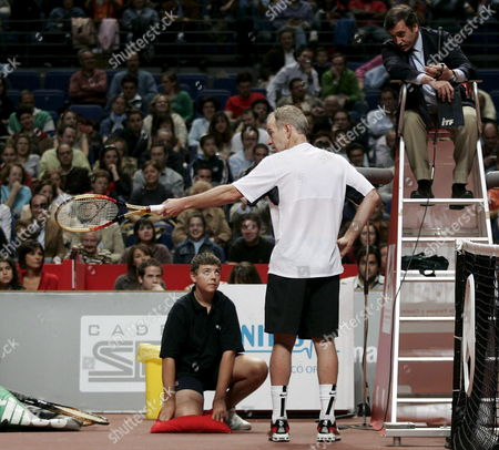 Us Tennis Player John Mcenroe (c) Argues with the Umpire During the Masters Senior Final Match He Played Against Spanish Albert Costa in Madrid Central Spain 15 April 2007 Costa Won the Tournament Spain Madrid