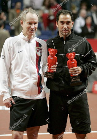 Spanish Tennis Player Albert Costa (r) and Us John Mcenroe Pose with Their Trophys After the Masters Senior Final Match in Madrid Central Spain 15 April 2007 Costa Won the Tournament Spain Madrid
