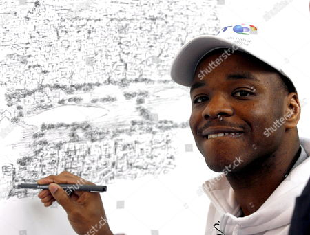 British Artist Stephen Wiltshire Known As 'The Human Camera' Paints an Aerial View of a Madrid's Downtown Landscape From Memory After He Took a Short Outing by Helicopter Lasting Less Than One Hour During His Visit in Madrid Spain 05 February 2008 Spain Madrid