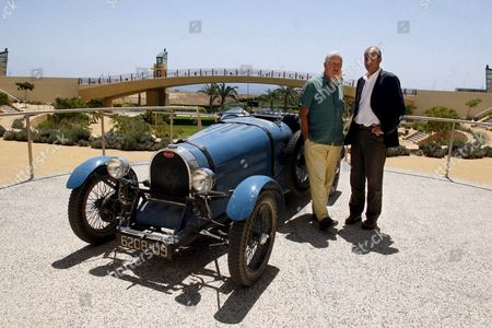 Brittish Film Maker John Irvin (r) Poses with Director of the 'Ciudad De La Luz' Studios Jose M Rodr?guez Galan (l) Near a Bugatti Car Used in the Filming of Irvin?s Latest Movie 'Garden of Eden' on 26 July 2007 in Alicante Eastern Spain the Film is Based on a Novel by Ernest Hemingway and Tells the Story of a Us Writer who Travels Along Europe in the Beginings of the Xx Century Spain Alicante