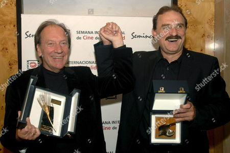 Serbian Film Director Goran Paskaljevic (l) and Serbian Actor Lazar Ristovski (r) Celebrate After Receiving Their Awards Gold and Silver Respectively For the Film 'Optimisti' at the 51th International Film Festival of Valladolid (seminci) in Valladolid Some 200 Kms Northwestern Madrid Saturday 28 October 2006 Spain Valladolid