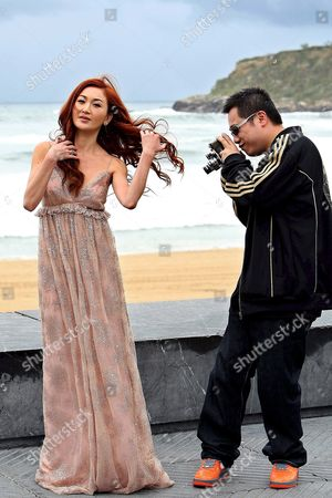 Stock Image of Chinese Film Director Pang Ho-cheung (r) Films Chinese Actress Irene Wan As They Pose For Photographers After the Screening of Her Film 'Exodus' 25 September 2007 During the 55th International Film Festival in San Sebastian Spain Spain San Sebastian